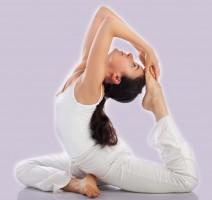 Young woman exercising yoga